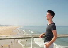 Young man smiling at the beach Royalty Free Stock Photo