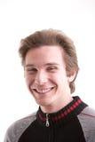 Young man smiling at camera royalty free stock image