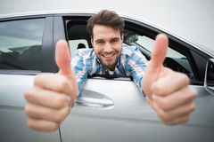 Young man smiling at camera showing thumbs up Royalty Free Stock Photography