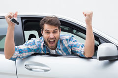 Young man smiling and cheering Royalty Free Stock Images