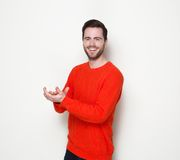 Young man smiling and clapping hands Royalty Free Stock Photo