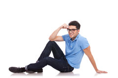 Young man smiling on the floor Royalty Free Stock Photos