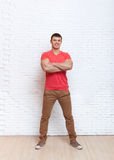 Young Man Smiling Folded Hands Stand Over Wall Royalty Free Stock Image
