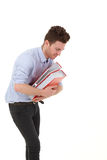 Young man smiling with folders Stock Photo