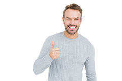 Young man smiling and giving a thumbs up Royalty Free Stock Images