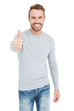Young man smiling and giving a thumbs up Stock Photos