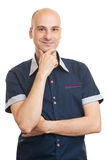 Young man smiling with hand on chin Stock Photo