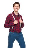 Young man smiling and holding suspenders Royalty Free Stock Images