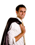 Young Man Smiling with Jacket Over Shoulder Royalty Free Stock Images