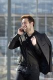 Young man smiling with mobile phone in the city Stock Photography