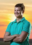 Young man smiling nature. Modern young man smiling nature sky sunset Royalty Free Stock Photography