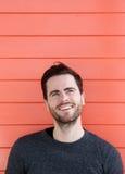 Young man smiling on orange background Royalty Free Stock Photo