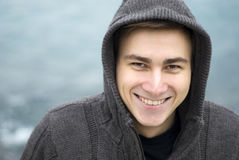 Young man smiling outdoors, portrait Stock Image
