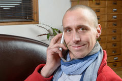 A young man smiling with a phone Stock Photos
