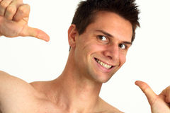 Young man smiling and pointing at himself. With success Stock Photography