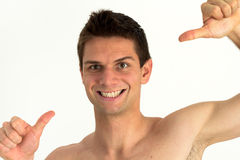 Young man smiling and pointing at himself. With success Royalty Free Stock Photo