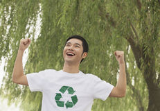 Young Man Smiling, Recycling Symbol, Beijing Stock Photo