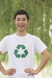 Young Man Smiling, Recycling Symbol, Beijing Stock Images