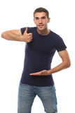Young man smiling and showing thumb ok Stock Photos