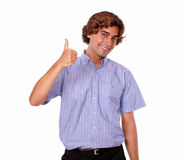 Young man smiling and showing you ok sign Royalty Free Stock Photos