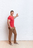 Young Man Smiling Standing Hand On Wall Copy Space Stock Images