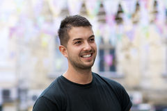 Young man with smiling  on the street Stock Image