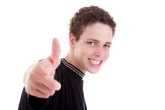 Young man smiling, with thumb up Stock Photography
