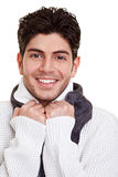 Young man smiling in winter. Young happy man with scarf smiling in winter Stock Photo