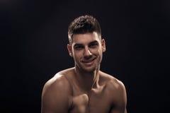 Young man smirk, headshot face. Head, closeup, black background royalty free stock photo