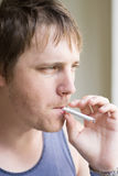 Young man smoking Stock Photos
