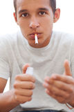 Young man smoking Stock Images