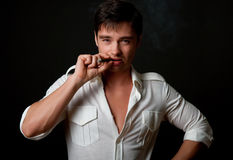 Young man smoking cigarette Royalty Free Stock Image