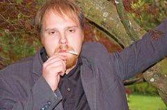 Young Man Smoking Cigarette Royalty Free Stock Image