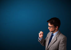 Young man smoking cigarette with copy space Stock Images