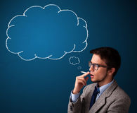 Young man smoking cigarette with idea cloud Royalty Free Stock Photos