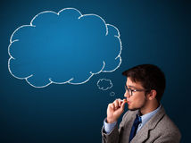 Young man smoking cigarette with idea cloud Stock Image