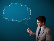 Young man smoking cigarette with idea cloud Stock Photos
