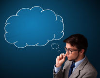 Young man smoking cigarette with idea cloud Stock Photo