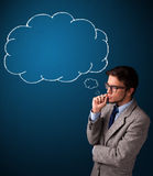 Young man smoking cigarette with idea cloud Stock Images