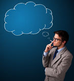 Young man smoking cigarette with idea cloud Royalty Free Stock Images
