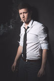 Young man smoking cigarette Royalty Free Stock Images