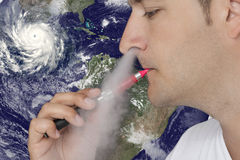 Young man smoking an electronic cigarette Royalty Free Stock Image