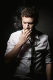 Young man smoking Stock Image