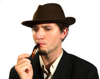 A young man smoking a pipe Stock Images