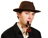 A young man smoking a pipe Stock Photography