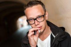 Young man smoking Stock Images
