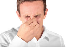 Young man sneezing royalty free stock photo