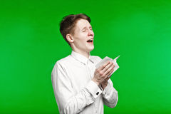 Young man sneezing and running nose Royalty Free Stock Images