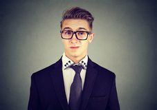 Young man with snobbish face expression. Young man with snobbish expression stock images