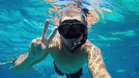 Young Man Snorkeling ang Making Underwater Selfie on GoPro. HD Slow Motion. Similan Island, Andaman, Thailand. stock video footage